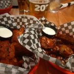 Two baskets of chicken wings and dipping sauce from wing night at the Drake