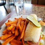 Close up of club sandwich and sweet potato fries taken during lunch at Patrino's